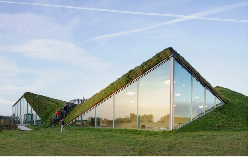 studio marco vermeulen tops renovated biesbosch museum with a grass roof